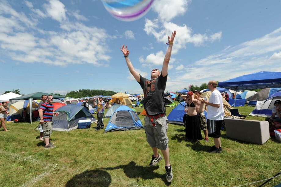 Aaron Glatfelter of Pennsylvania plays with a large beach ball in the camping area  during Camp Bisco on Thursday July 11, 2013 in Mariaville, N.Y. (Michael P. Farrell/Times Union) Photo: Michael P. Farrell / 00023098A