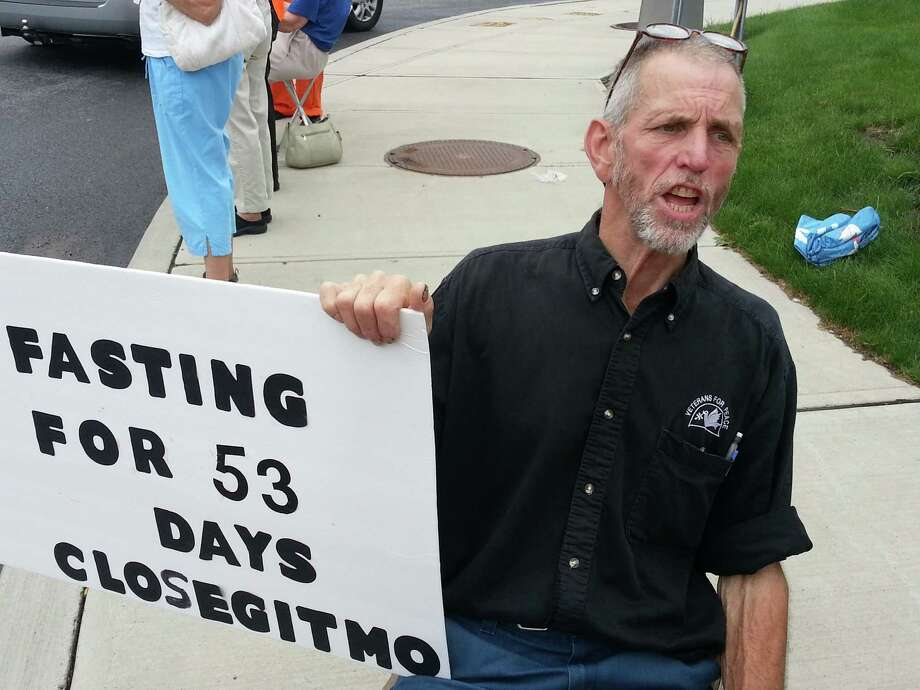 Vietnam veteran Elliott Adams, 66, of Sharon Springs, protest against the Guantanamo Bay U.S. Naval Base prison facility, Wednesday evening, July 10, 2013, on Wolf Road in Colonie, N.Y.  Adams has been fasting for over fifty days in protest to the force-feeding of detainees at Guantanamo Bay.  Adams has limited himself to 300 calories for eight weeks. HeOs down to 138 pounds from 170. (Dennis Yusko/Times Union)