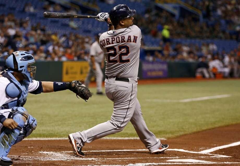 Carlos Corporan follows through on a two-run single in the first inning.