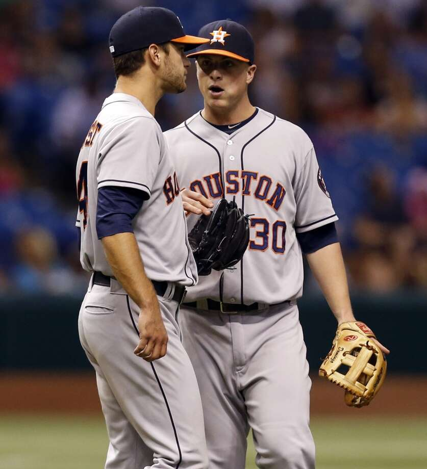 Astros third baseman Matt Dominguez talks to starting pitcher Jarred Cosart after he gave up his first hit during the seventh inning.