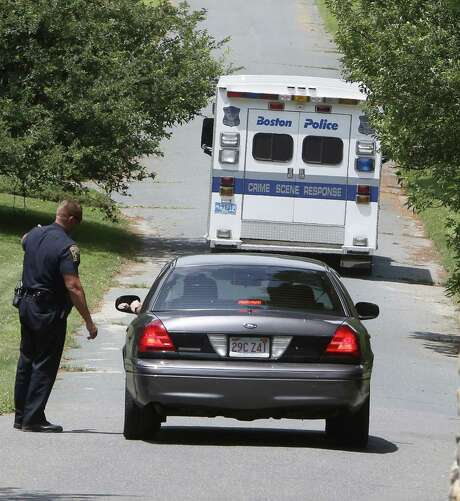 A Boston police van enters the cemetery in Peabody, Mass., where authorities plan to exhume Albert DeSalvo's body. Photo: Associated Press