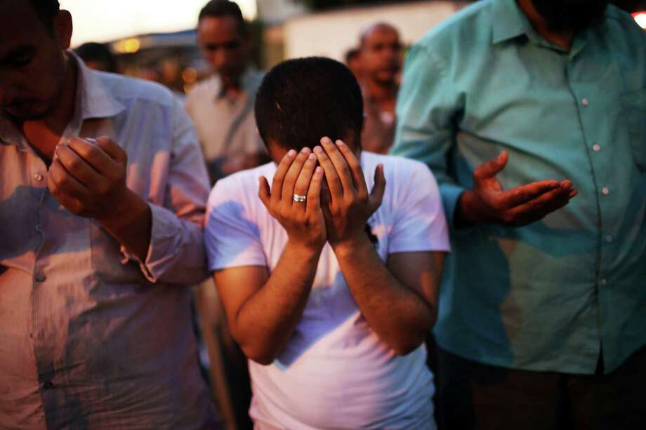 In Cairo supporters of the ousted president, Mohamed Morsi, participate in the Friday evening prayer on the third day of Ramadan, the sacred holy month for Muslims. Photo: Spencer Platt / Getty Images