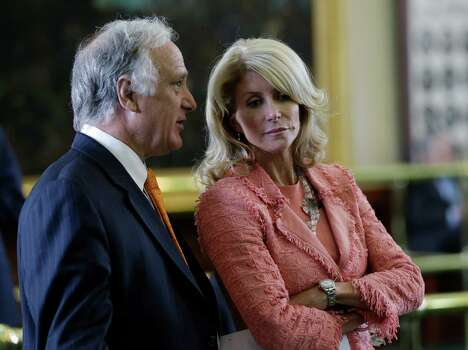 Sen. Kirk Watson, D-Austin, left, and Sen. Wendy Davis, D-FortWorth, right, talk as the Texas Senate debates an abortion bill, Friday, July 12, 2013, in Austin, Texas. The bill would require doctors to have admitting privileges at nearby hospitals, only allow abortions in surgical centers, dictate when abortion pills are taken and ban abortions after 20 weeks. Photo: Eric Gay, Associated Press / AP