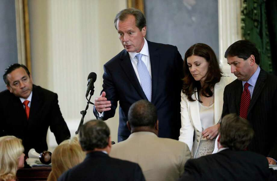 Lt. Governor David Dewhurst, top center, talks with Texas Senators during a point of order in their debate over abortion legislation, Friday, July 12, 2013, in Austin, Texas. The bill would require doctors to have admitting privileges at nearby hospitals, only allow abortions in surgical centers, dictate when abortion pills are taken and ban abortions after 20 weeks. Photo: Eric Gay, Associated Press / AP