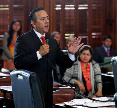 Senator Carlos Ureste argues for his amendment as the Senate debates passage of abortion legislation on July 12, 2013. Photo: TOM REEL