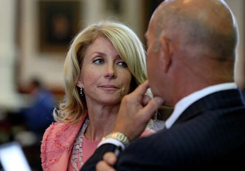 Senator Wendy Davis (D-Fort Worth) listens to John Whitmire (D-Houston) as the Senate debates passage of abortion legislation on July 12, 2013. Photo: TOM REEL