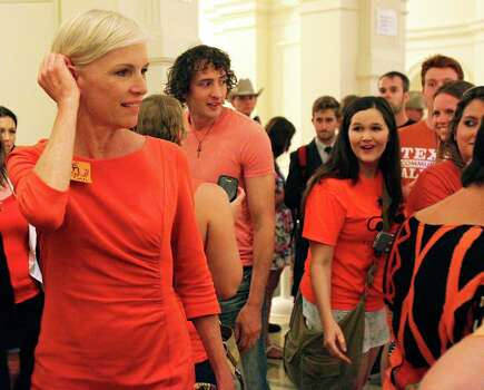 Cecile Richards greets supporters as she walks through the Capitol Friday evening as the Senate debates passage of abortion legislation on July 12, 2013. Photo: TOM REEL