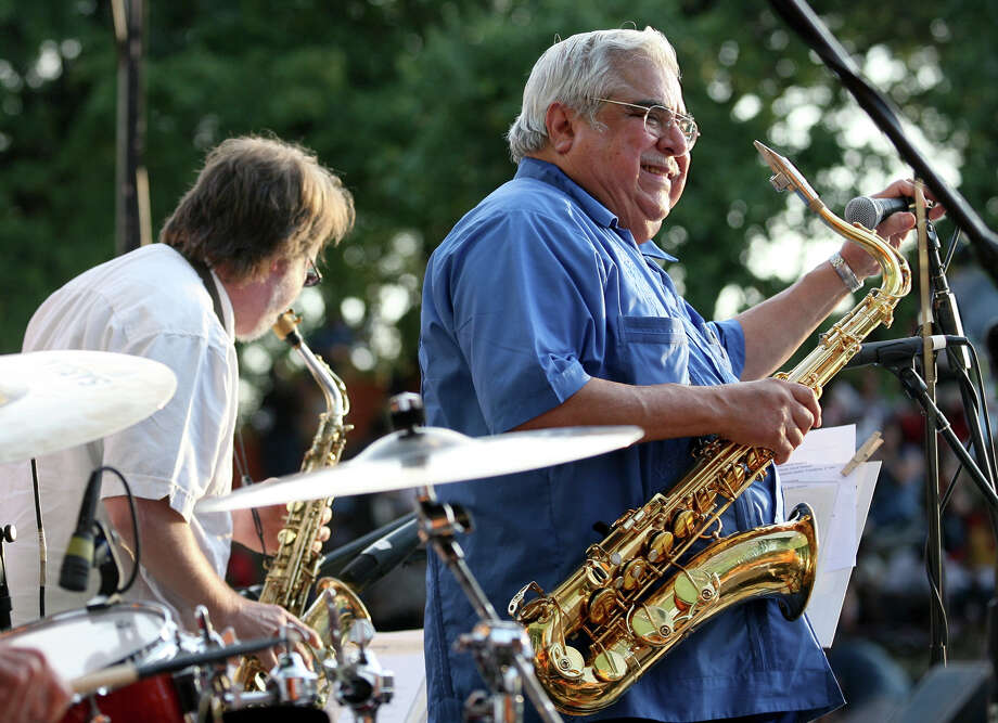 Precinct 2 Commissioner Paul Elizondo plays with the Paul Elizondo Orchestra July 12, 2013 during the Balcones Heights Jazz Festival at Wonderland of the Americas Amphitheater. Elizondo retired from performing three years ago but the group got back together for the jazz festival. Photo: Cynthia Esparza, For The San Antonio Express-News / For San Antonio Express-News