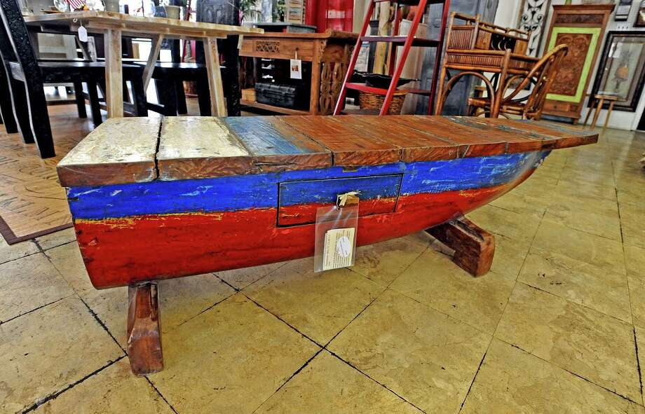 Balimports in Beaumont offers a canoe coffee table made of repurposed boat wood.  Photo taken Friday, July 12, 2013. Photo taken: Randy Edwards/The Enterprise