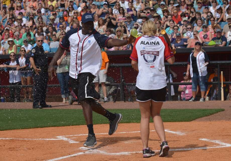 Lauren Alaina is hit with a water balloon by Tennessee Titans player Jared Cook during City Of Hope's 2012 Celebrity Softball Challenge on June 9, 2012 in Nashville, Tenn.