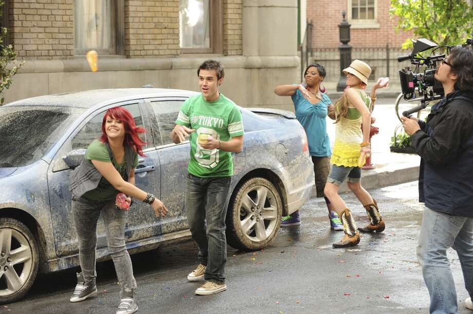 American Idol contestants  throw water balloons during the making of the Ford American Idol Music Video on March 15, 2009 in Los Angeles.