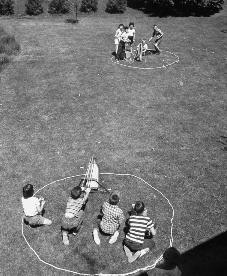 Children plays with Splash Bomb toys in 1954.