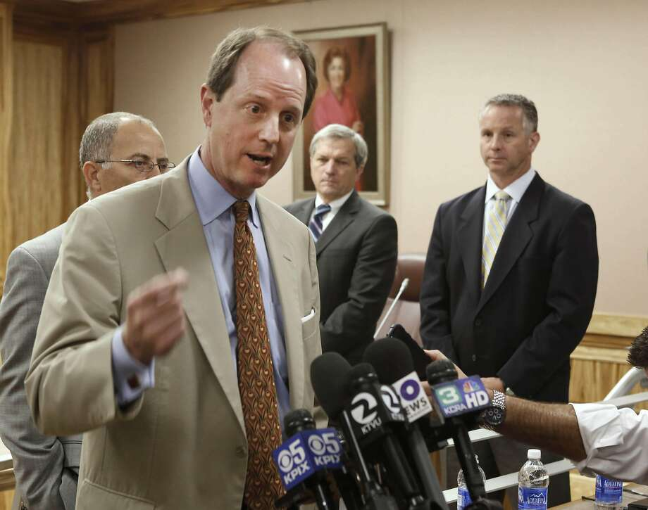 Steve Heminger, executive director of the the Bay Area Toll Authority and chairman of the Toll Bridge Program Oversight Committee, left,  discusses the delay of the opening of the eastern span of the San Francisco-Oakland Bay Bridge, following a meeting with lawmakers in Sacramento, Calif., Monday, July 8, 2013. The new opening date for the $6.4 billion crossing, which had been set for Labor Day, will be delayed until after the retrofitting of failed seismic bolts is completed in December. In the background are state senators Mark DeSaulnier, D-Concord, second from right, Anthony Cannella, R-Ceres, right. (AP Photo/Rich Pedroncelli) Photo: Rich Pedroncelli, Associated Press