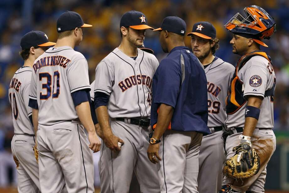 Astros manager Bo Porter removes starting pitcher Jarred Cosart during the ninth inning.