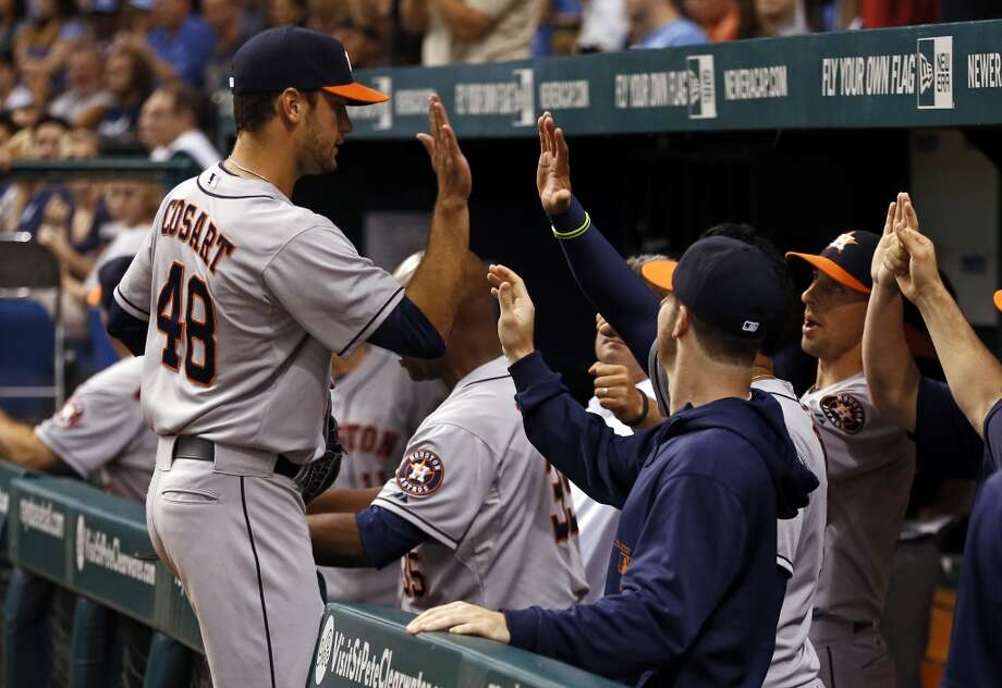 Astros starting pitcher Jarred Cosart is congratulated by teammates after his Major League debut.