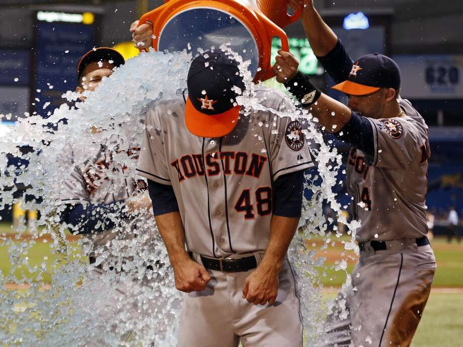July 12: Astros 2, Rays 1Astros starting pitcher Jarred Cosart is doused with water by teammates Brandon Barnes, left, and J.D. Martinez during a TV interview following his win in his major league debut.