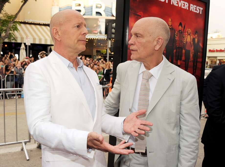 "Actors Bruce Willis (L) and John Malkovich attend the premiere of Summit Entertainment's ""RED 2"" at Westwood Village on July 11, 2013 in Los Angeles, California.  (Photo by Kevin Winter/Getty Images)"