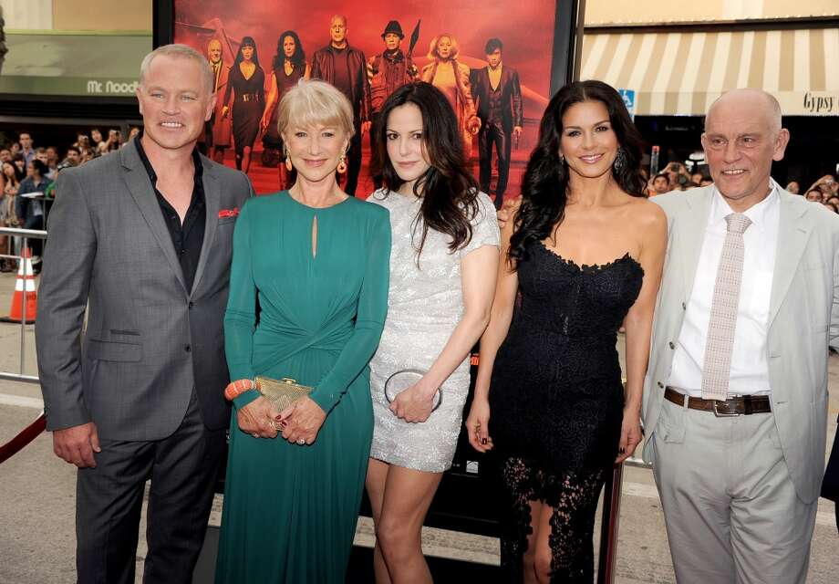 "(L-R) Actors Neal McDonough, Helen Mirren, Mary-Louise Parker, Catherine Zeta-Jones and John Malkovich attend the premiere of Summit Entertainment's ""RED 2"" at Westwood Village on July 11, 2013 in Los Angeles, California.  (Photo by Kevin Winter/Getty Images)"