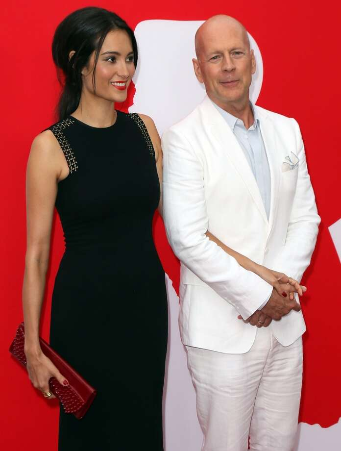 "Emma Heming Willis (L) and husband actor Bruce Willis attend the premiere of Summit Entertainment's ""RED 2"" at Westwood Village on July 11, 2013 in Los Angeles, California.  (Photo by David Livingston/Getty Images)"