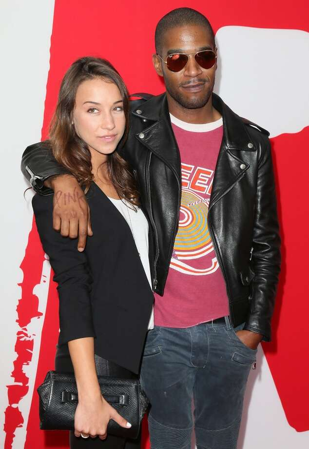 "Actress Stella Maeve (L) and hip-hop artist Kid Cudi attend the premiere of Summit Entertainment's ""RED 2"" at Westwood Village on July 11, 2013 in Los Angeles, California.  (Photo by David Livingston/Getty Images)"