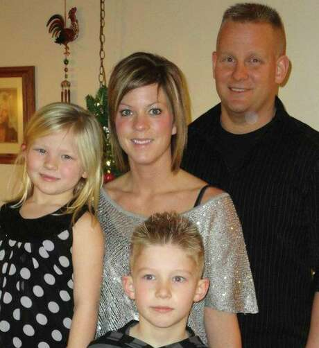Dental assistant Melissa Nelson, shown with her family, was fired at the dentist's wife's request. Photo: Courtesy Of Melissa Nelson