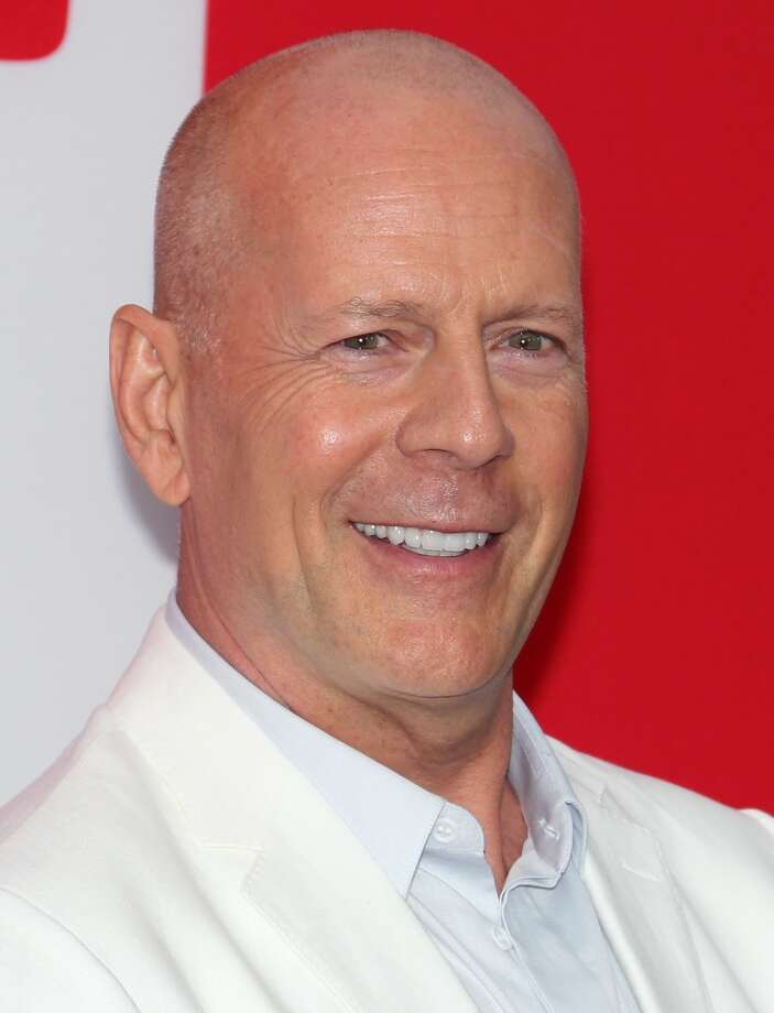 "Actor Bruce Willis attends the premiere of Summit Entertainment's ""RED 2"" at Westwood Village on July 11, 2013 in Los Angeles, California.  (Photo by David Livingston/Getty Images)"