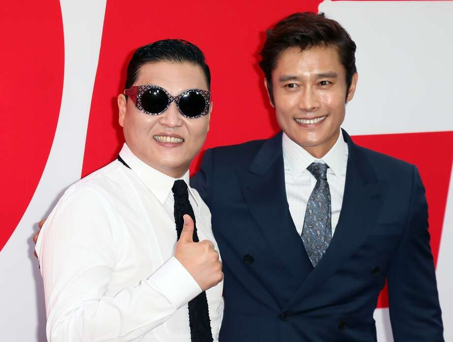 "Singer Psy (L) and actor Byung-hun Lee attend the premiere of Summit Entertainment's ""RED 2"" at Westwood Village on July 11, 2013 in Los Angeles, California.  (Photo by David Livingston/Getty Images)"