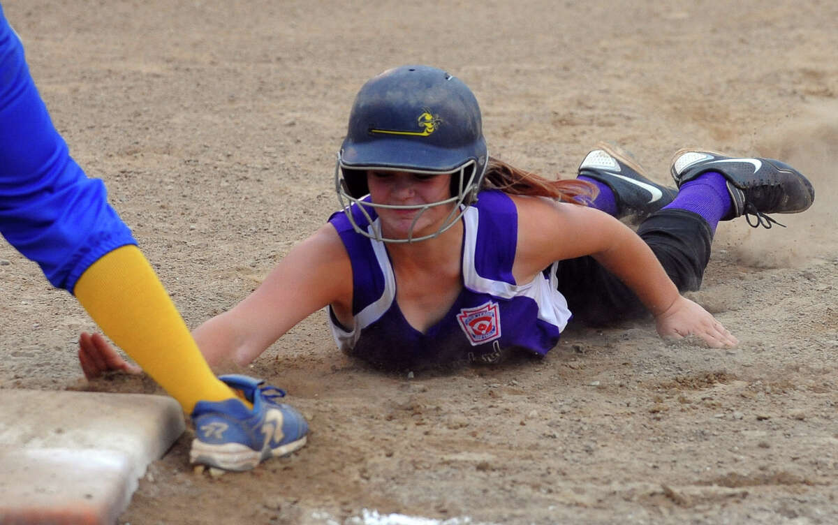 District 1 little league softball championship action between Seymour and North Branford in Orange, Conn. on Friday July 12, 2013.