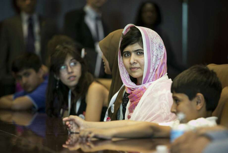 "Malala Yousafzai, shot in the head by the Taliban in 2012 for advocating the education of girls, made a speech at the U.N. in New York City on Friday, her birthday, calling on world leaders to provide ""free, compulsory education"" for every child. Photo: Todd Heisler / New York Times"