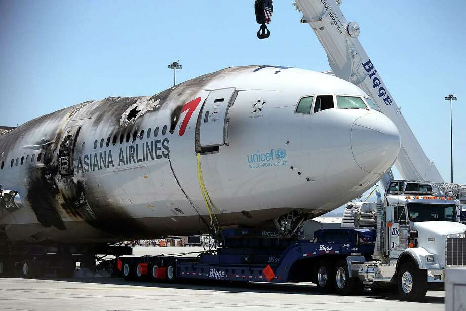 The wrecked fuselage of Asiana Airlines Flight 214 sits in a storage area at San Francisco International Airport. Photo: Justin Sullivan / Getty Images
