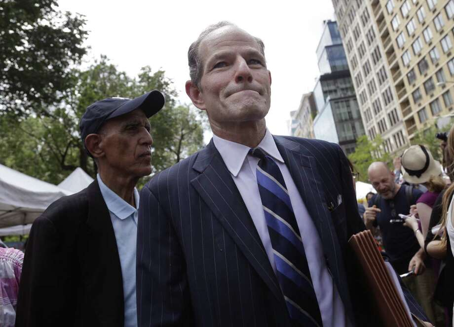 Former New York Gov. Eliot Spitzer walks through Union Square collecting signatures Monday for his run for New York City comptroller. His rival declined to challenge the petitions. Photo: Associated Press