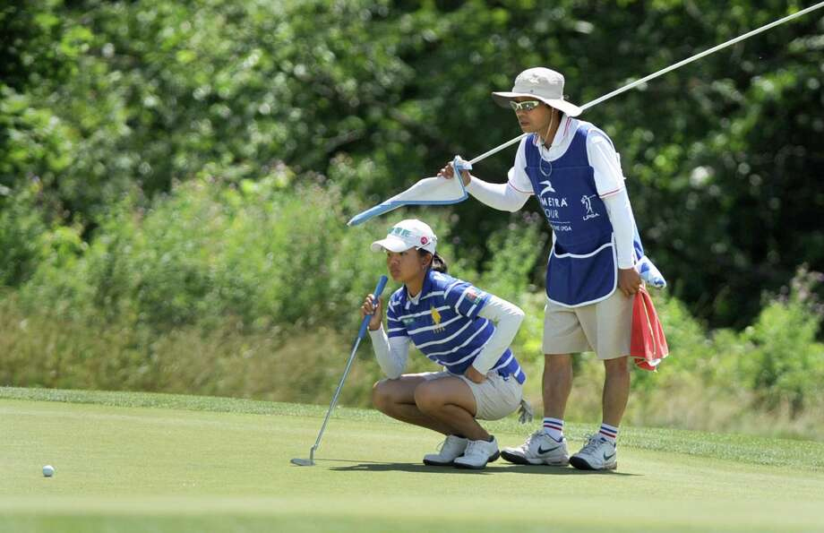 Wei-Ling Hsu of Chinese Taipei and her caddy try to read her next putt during the opening round of the Credit Union Challenge, the Symetra Tour stop at Capital Hills Golf Course Friday, July 12, 2013 in Albany, N.Y. (Lori Van Buren / Times Union) Photo: Lori Van Buren / 10023131A