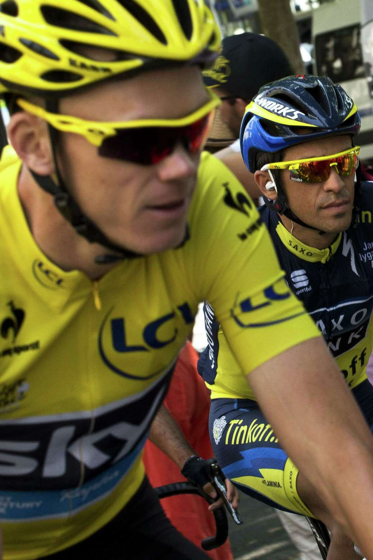Yellow jersey holder Christopher Froome was unable to pad his lead as Alberto Contador, right, moved more than a minute closer to the leader.