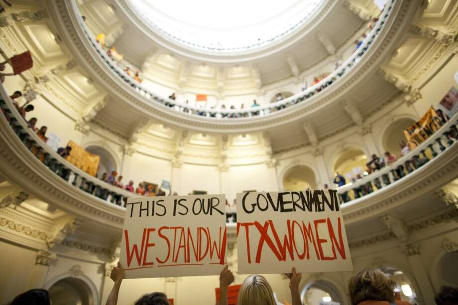 Abortion rights supporters rally on the floor of the State Capitol rotunda in Austin, Texas on Friday, July 12, 2013. The Texas Senate convened Friday afternoon to debate and ultimately vote on some of the nation's toughest abortion restrictions, its actions being watched by fervent demonstrators on either side of the issue. (AP Photo/Tamir Kalifa) Photo: AP