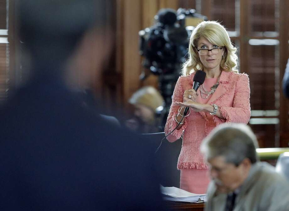 Sen. Wendy Davis, D-FortWorth, right, asks questions of abortion bill author Sen. Glenn Hegar, R-Katy, left, as the Texas Senate debates the abortion legislation, Friday, July 12, 2013, in Austin, Texas. The bill would require doctors to have admitting privileges at nearby hospitals, only allow abortions in surgical centers, dictate when abortion pills are taken and ban abortions after 20 weeks. (AP Photo/Eric Gay) Photo: AP