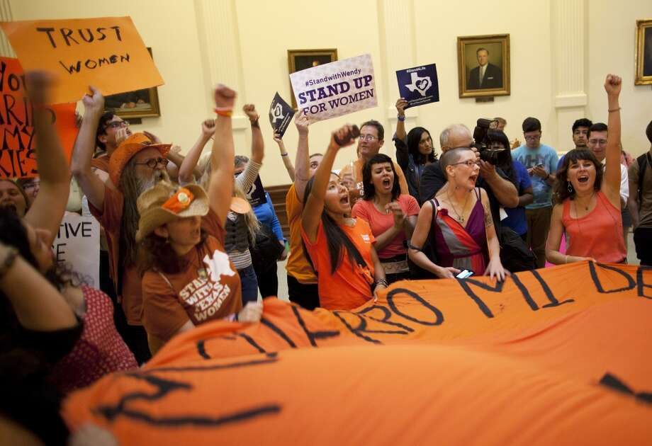Abortion rights supporters rally on the floor of the State Capitol's rotunda in Austin, Texas on Friday, July 12, 2013. The Texas Senate's leader, Lt. Gov. David Dewhurst, has scheduled a vote for Friday on the same restrictions on when, where and how women may obtain abortions in Texas that failed to become law after a Democratic filibuster and raucous protesters were able to run out the clock on an earlier special session. (AP Photo/Tamir Kalifa) Photo: AP