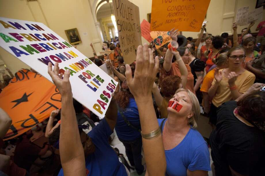 Opponents and supporters of abortion rights rally in the State Capitol rotunda in Austin, Texas on Friday, July 12, 2013. The Texas Senate convened Friday afternoon to debate and ultimately vote on some of the nation's toughest abortion restrictions, its actions being watched by fervent demonstrators on either side of the issue. (AP Photo/Tamir Kalifa) Photo: AP