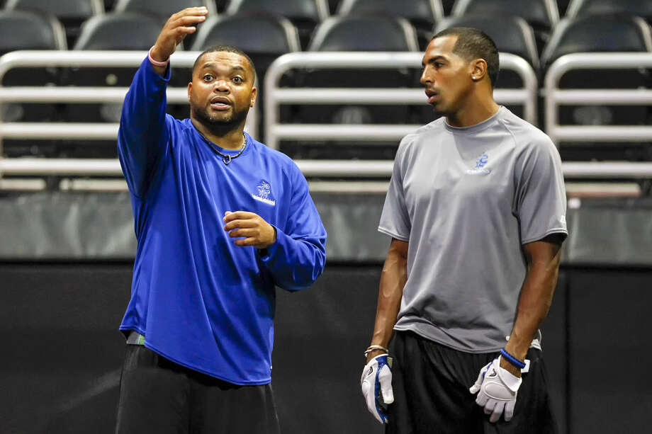 Talons offensive coordinator Raymond Philyaw (left), working with receiver Burl Toler, is in his second year as an assistant. Photo: Marvin Pfeiffer / San Antonio Express-News