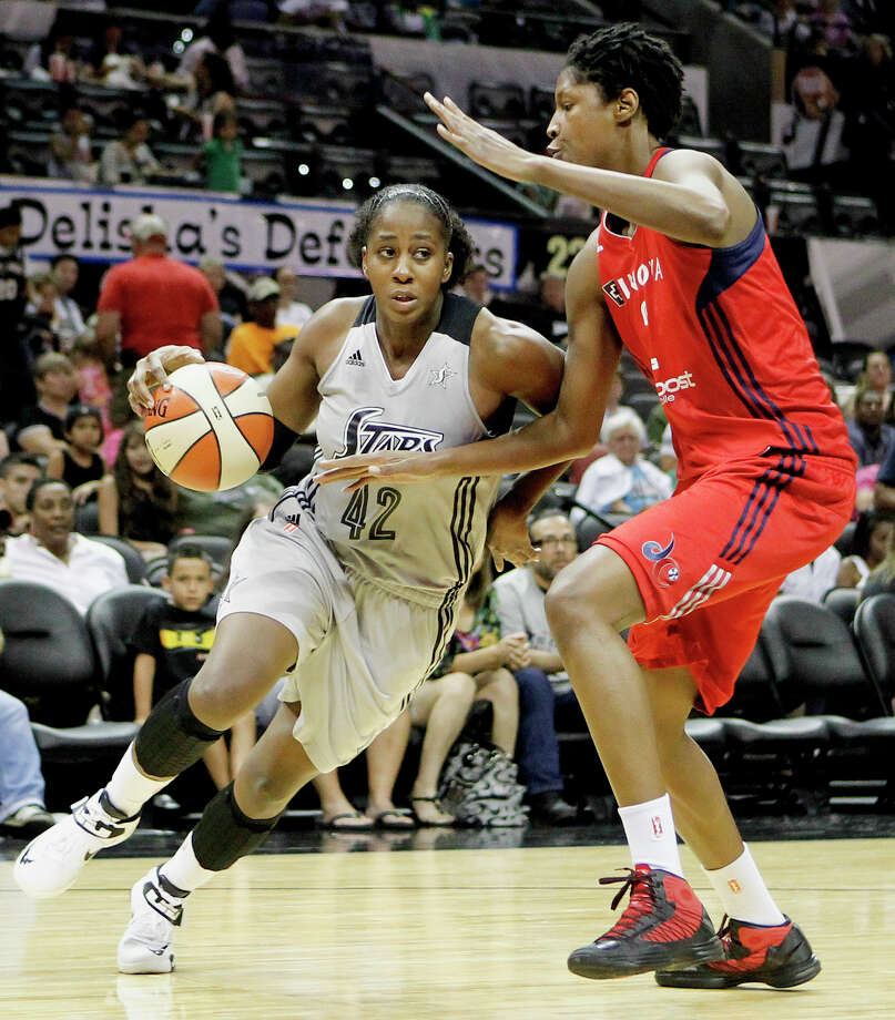 Shenise Johnson of the Silver Stars (left) drives around Michelle Snow of the Washington Mystics during the third quarter of their game at the AT&T Center on Friday, July 12, 2013.  The Mystics downed the Silver Stars 83-73.  MARVIN PFEIFFER/ mpfeiffer@express-news.net Photo: Marvin Pfeiffer/ Express-News / Express-News 2013