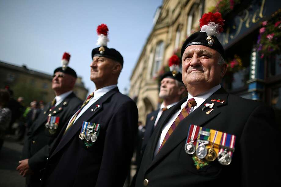 BURY, ENGLAND - JULY 12:  A group of veterans wait for the start of the funeral service for Fusilier Lee Rigby at Bury Parish Church on July 12, 2013 in Bury, England. The Royal Regiment of Fusiliers soldier was killed whilst off duty in London in May. Michael Adebowale and Michael Adebolajo are accused of Fusilier Rigby's murder.  (Photo by Peter Macdiarmid/Getty Images) Photo: Peter Macdiarmid, Getty Images