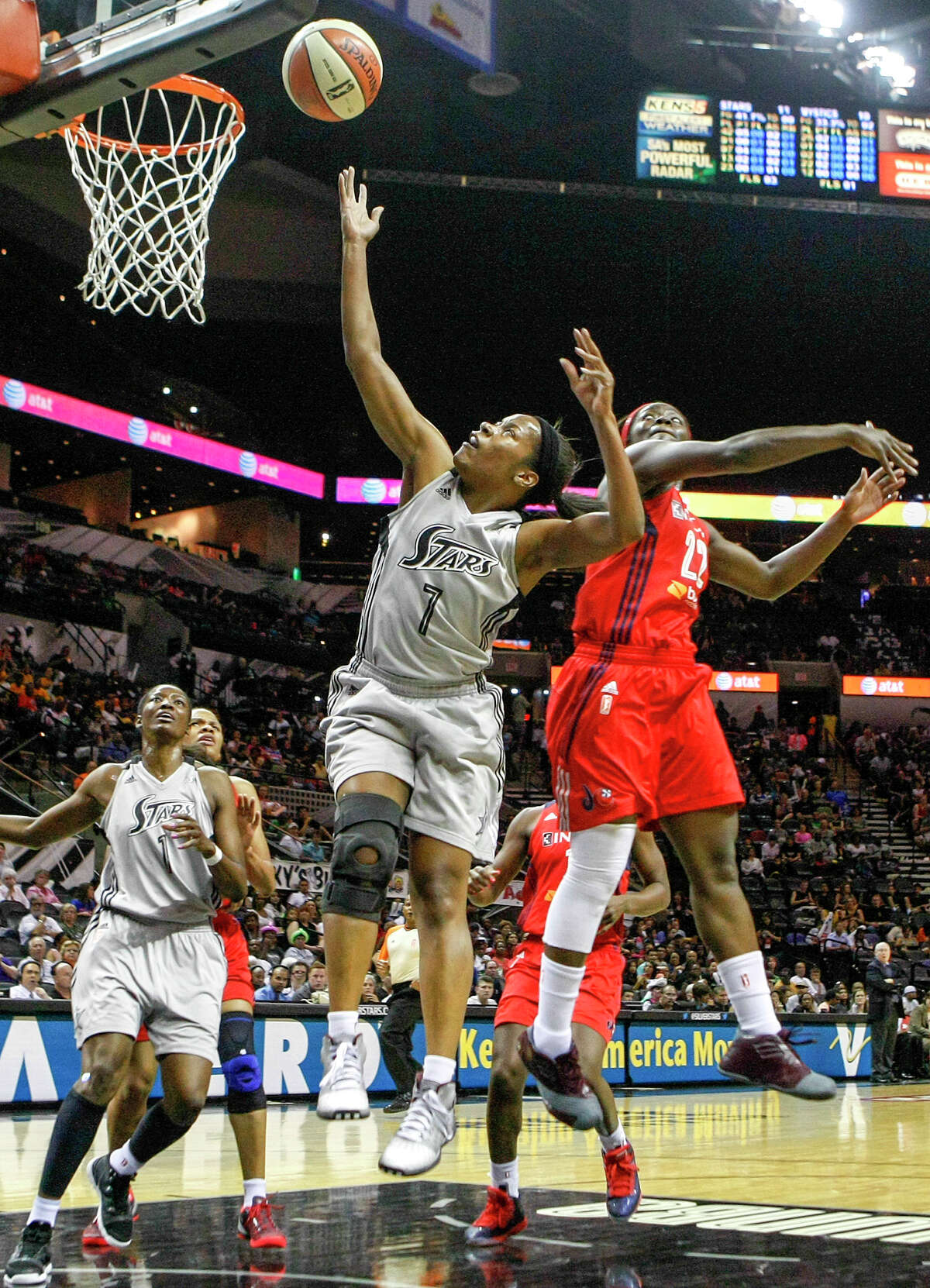 Jia Perkins of the Silver Stars (center) goes up for a layup during the first quarter of their game with the Washington Mystics at the AT&T Center on Friday, July 12, 2013. The Mystics beat the Silver Stars 83-73.MARVIN PFEIFFER/ mpfeiffer@express-news.net