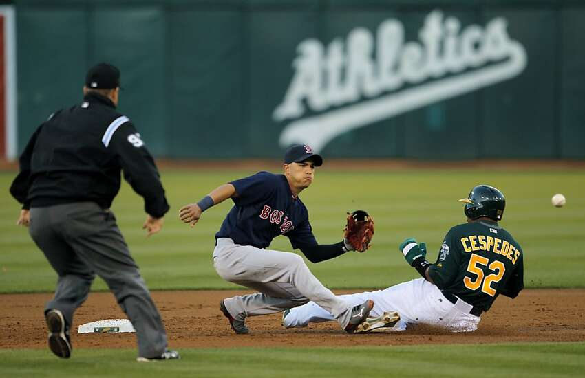 Yoenis Cespedes steals second in the second inning. The Oakland Athletics played the Boston Red Sox on Friday, July 12, 2013, at the O.co Coliseum in Oakland, Calif.