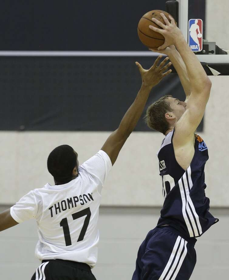 Charlotte Bobcats Cody Zeller gets past San Antonio Spurs Hollis Thompson for a dunk in the second quarter of an NBA Summer League game, Friday, July 12, 2013, in Las Vegas. (AP Photo/Julie Jacobson)