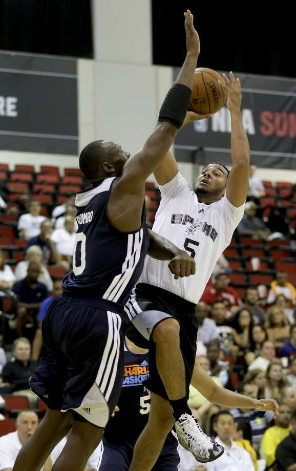 San Antonio Spurs Cory Joseph (5) shoots against Charlotte Bobcats Bismack Biyombo in the second quarter of an NBA Summer League game, Friday, July 12, 2013, in Las Vegas. (AP Photo/Julie Jacobson)