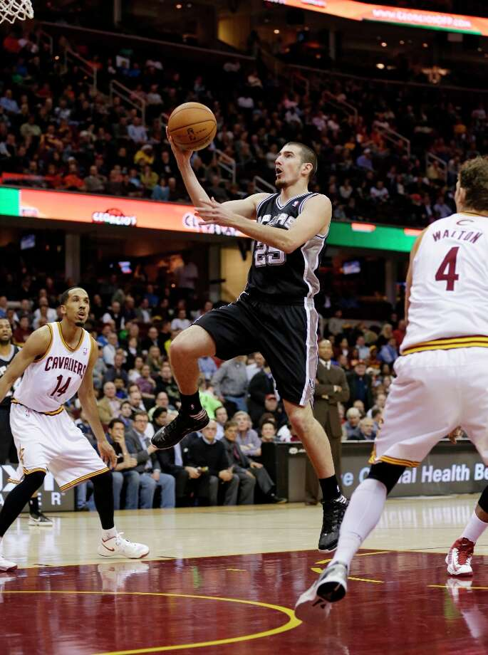 The Spurs' Nando de Colo (25) jumps to the basket against the Cleveland Cavaliers Wednesday, Feb. 13, 2013, in Cleveland. Photo: Tony Dejak, Associated Press / AP