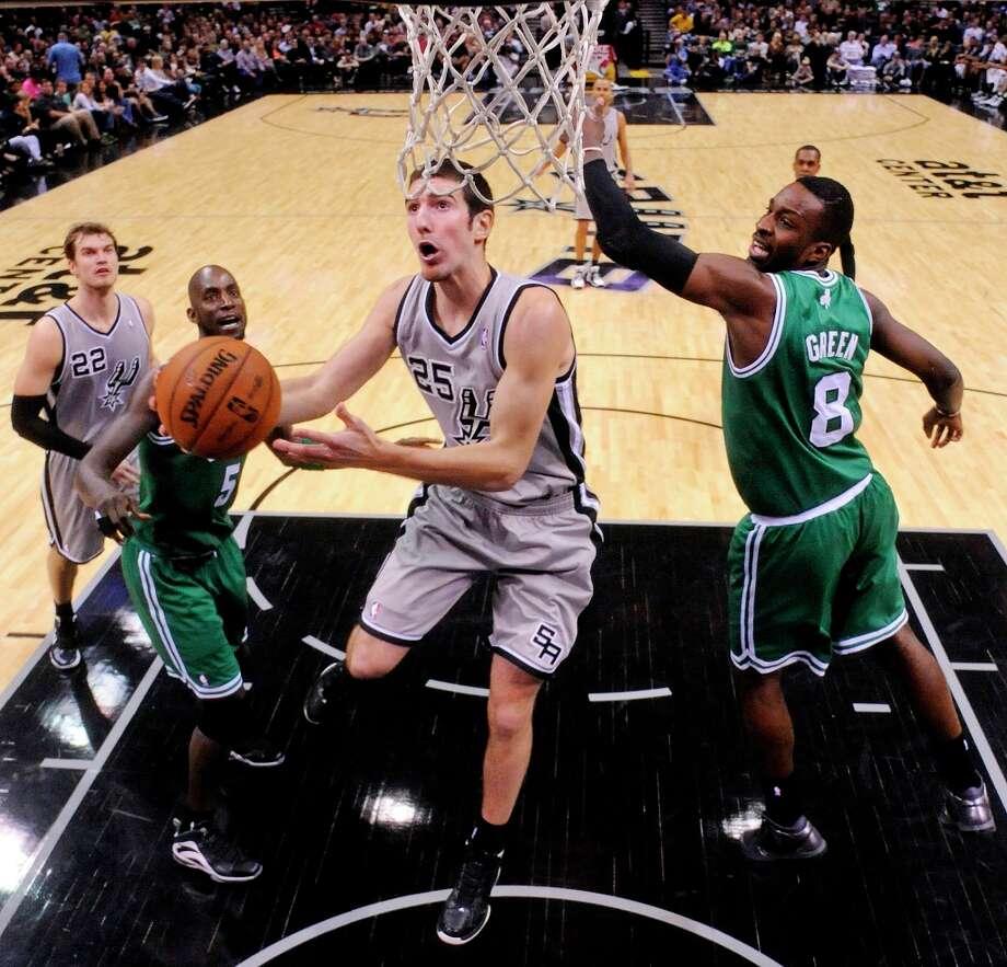 The Spurs' Nando De Colo shoots around Boston Celtics' Jeff Green during second half action Saturday, Dec. 15, 2012 at the AT&T Center. The Spurs won 103-88. Photo: Edward A. Ornelas, San Antonio Express-News / © 2012 San Antonio Express-News