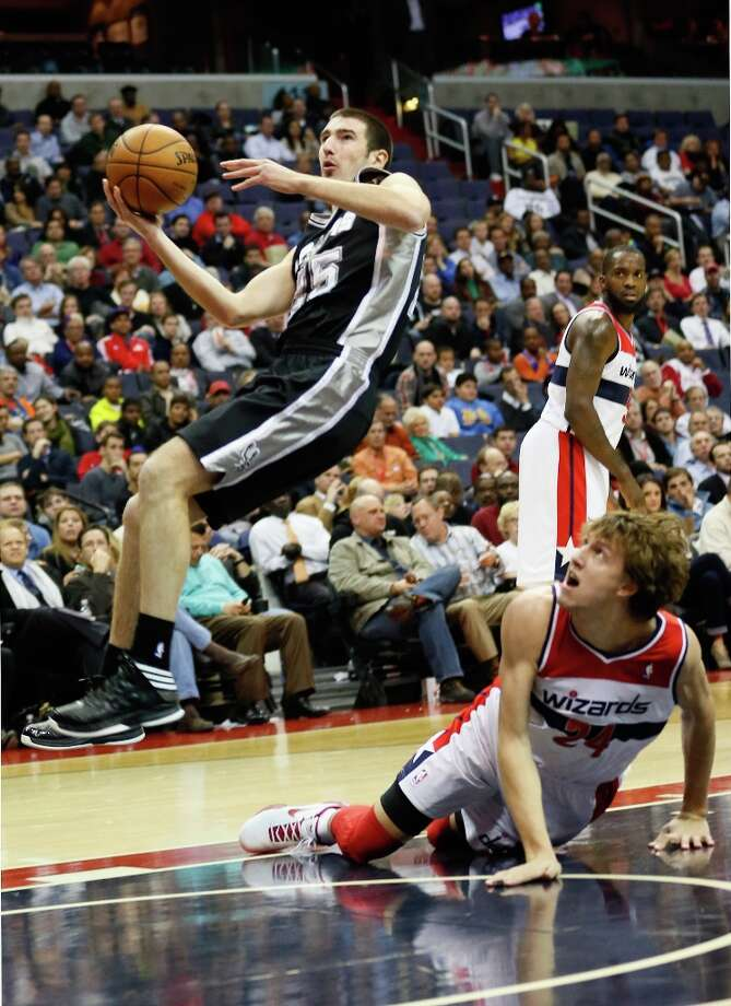 Nando de Colo (25) of the Spurs puts up a shot in front of Jan Vesely (24) of the Washington Wizards during the second half at Verizon Center on Nov. 26, 2012 in Washington, DC. Photo: Rob Carr, Getty Images / 2012 Getty Images
