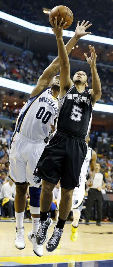 San Antonio Spurs' Cory Joseph shoots around Memphis Grizzlies' Darrell Arthur during first half action in Game 4 of the 2013 Western Conference finals Monday May 27, 2013 at the FedEx Forum in Memphis, Tenn.