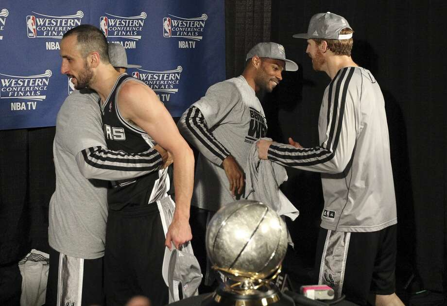 Manu Ginobili gets hugged by teammate Cory Joseph while Gary Neal (second from right) and Matt Bonner also celebrate as the San Antonio Spurs defeated the Memphis Grizzlies for the 2013 Western Conference Championship at the FedEx Forum in Memphis on Monday, May 27, 2013.