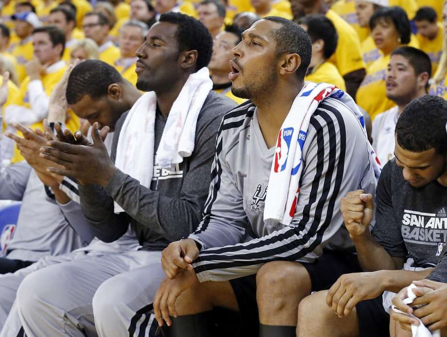 San Antonio Spurs' Tracy McGrady (from left), San Antonio Spurs' DeJuan Blair, San Antonio Spurs' Boris Diaw and San Antonio Spurs' Cory Joseph react on the bench after a play during second half action of Game 6 in the NBA Western Conference semifinals against the Golden State Warriors Thursday  May 16, 2013 at Oracle Arena in Oakland, CA. The Spurs won 94-82.